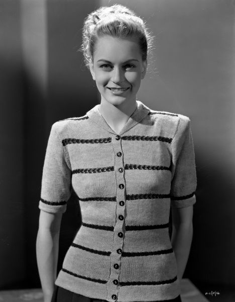 Carol Marsh smiles directly at the camera wearing a fashionable top for the release of Brighton Rock (1947)