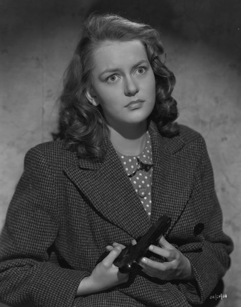 Carol Marsh with a scared expression holds a gun in a portrait for John Boulting's Brighton Rock (1947) based on the Graham Greene's novel