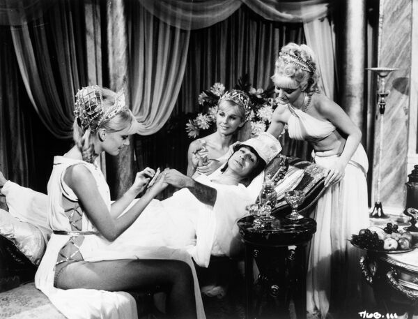 Kenneth Connor as Hengist Pod enjoys a manicure by three Roman beauties