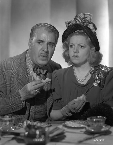 George Carney and Hermione Baddeley as Phil Corkery and Ida Arnold look perplexed in a studio image for the release of Brighton Rock (1947)