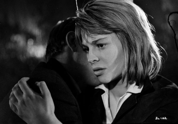 Julie Christie as Liz embraces Tom Courtenay (obscured) in a dramatic moment from John Schlesinger's Billy Liar (1963)
