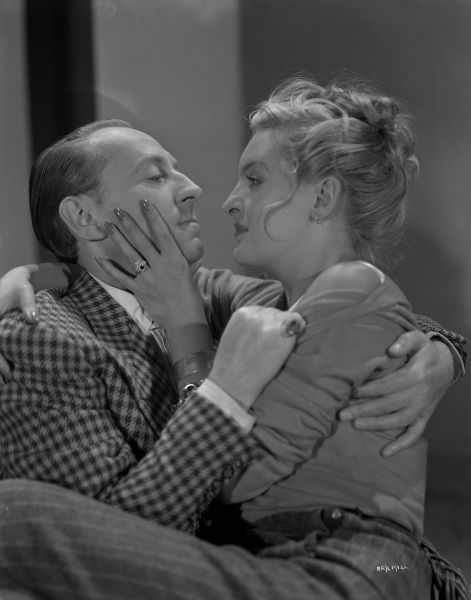 William Hartnell and Virgina Winter in character embrace in a promotional image for the release of John Boulting's Brighton Rock