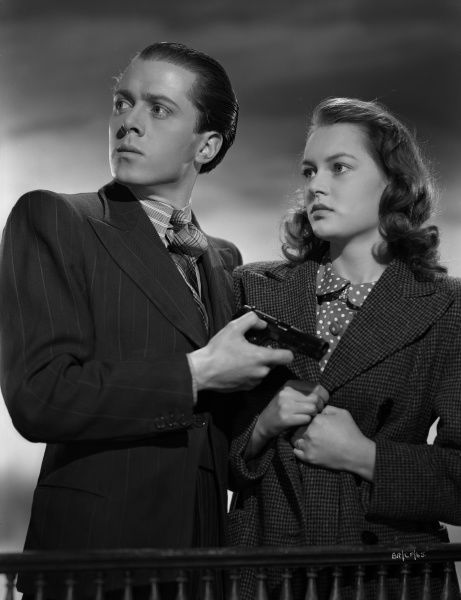 Richard Attenborough and Carol Marsh in character to promote the release of the thriller directed by John Boulting in 1947