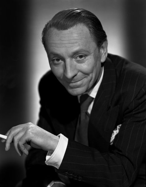 A smiling portrait of actor William Hartnell