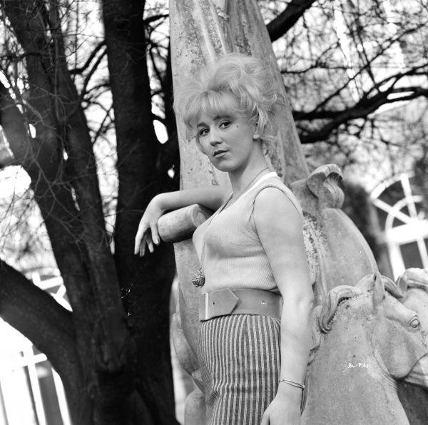 Gwendolyn Watts poses next to a tree for a promotional portrait for the UK release of Billy Liar in 1963