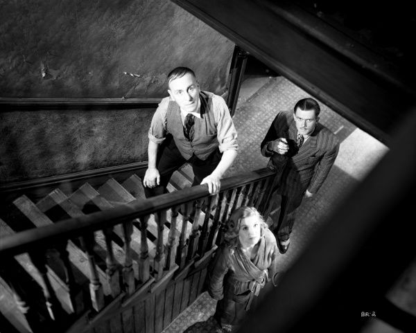 Wylie Watson, Nigel Stock and Virginia Winter in a scene set in the hideout of Pinkie the gangster in John Boulting's Brighton Rock (1947)
