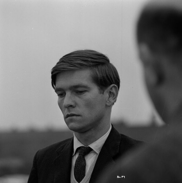 A very serious looking Tom Courtenay in a pause of the filming of Billy Liar in 1963. Obscured in the foreground is director John Schlesinger