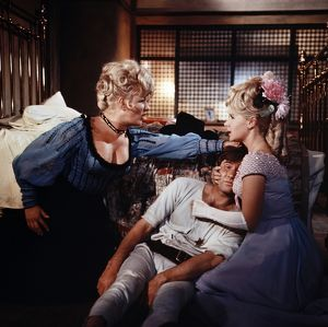 Joan Sims, Jim Dale and Angela Douglas in a scene from Carry On Cowboy