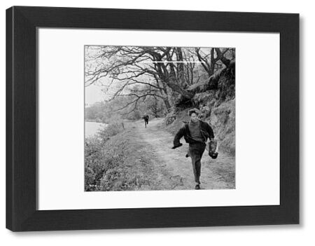 The wee boy runs. Tommy Kearins in a scene from the Maggie (1954)