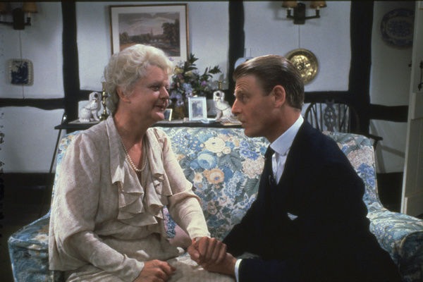 Angela Lansbury as Miss Murple and Edward Fox as Inspector Craddock in a scene from The Mirror Crack'd (1980)