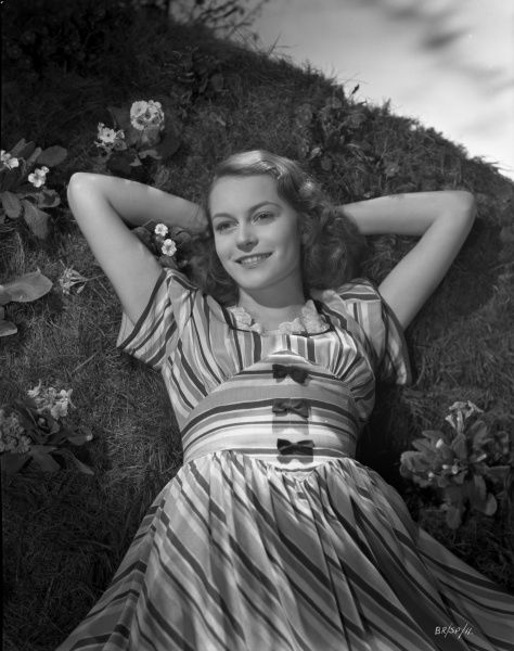 A smiling Carol Marsh poses for a promotional portrait for the UK release of John Boulting's Brighton Rock (1947). It was her big screen debut