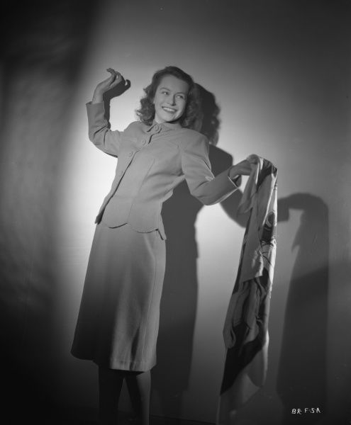 Carol Marsh smiles jokingly holding a scarf in a fashion shoot to promote her role as Rose in Brighton Rock (1947)
