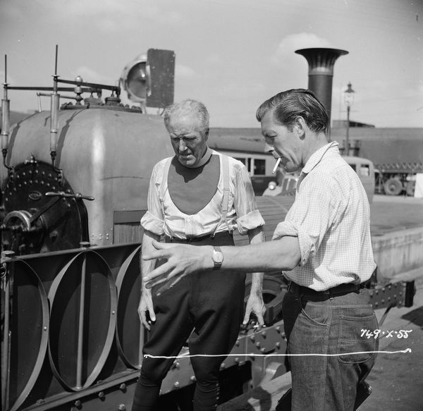 discussing a shot on location for The Titfield Thunderbolt