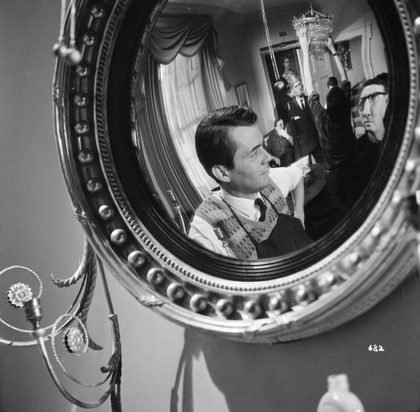 During a pause of the filming for Joseph Losey's The Servant this unusual portrait of actor Dirk Bogarde is taken reflected in a mirror