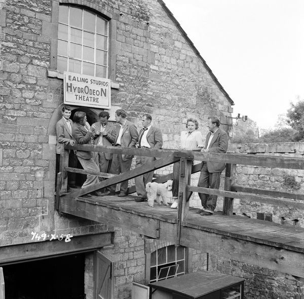 and other crew members outside a makeshift viewing theatre on location for the Titfield Thunderbolt