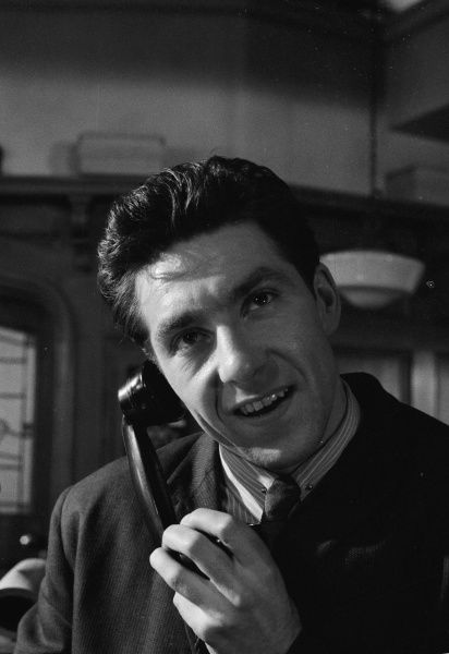 George Innes (Stamp) smiles while on the phone in a scene from Billy Liar (1963)