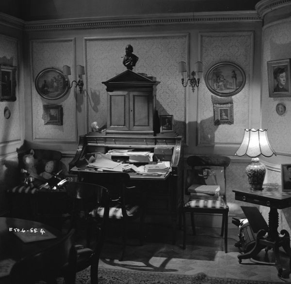 A drawing room is littered with children toys for a scene from Young Wives Tale (1951), the art director was Bill Beavis