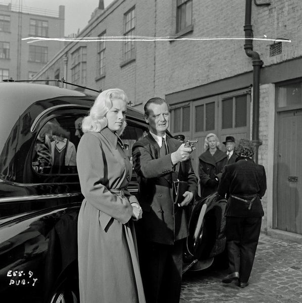 on location at Belgrave Mews in London during the filming of Yield to the Night