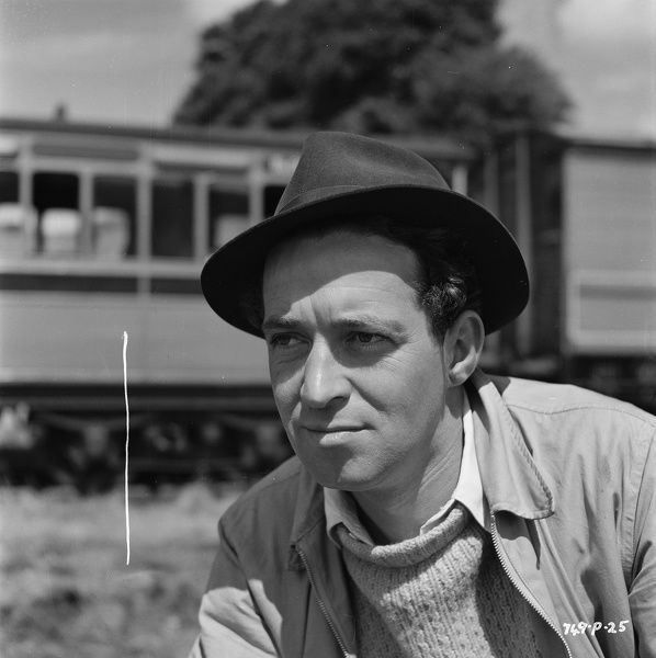 with a hat on location for the filming of The Titfield Thunderbolt