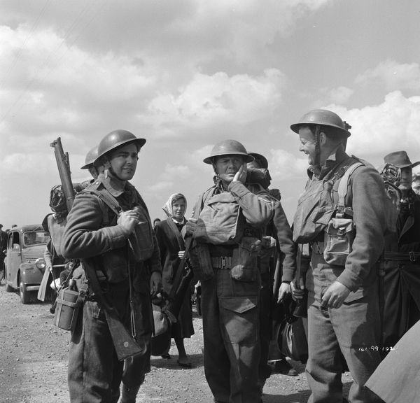 amongst French civilians and British Soldiers on the way towards the coastline in a scene from Dunkirk (1958)