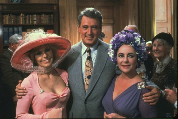 Kim Novak as Lola Brewster, Rock Hudson and Elizabeth Taylor as Jason and Marina Rudd smile during the party sequence of Guy Hamilton's The Mirror Crack'd (1980)