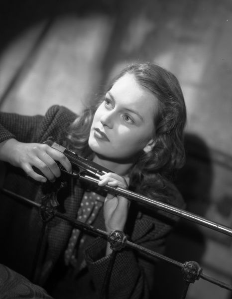 Carol Marsh as Rose holds a gun in John Boulting's Brighton Rock (1947) based on the Graham Greene's novel