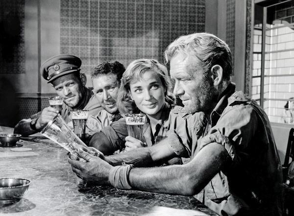 Harry Andrews, Anthony Quayle, Sylvia Syms and John Mills in scene from Jack Lee Thompson's classic war title Ice Cold in Alex
