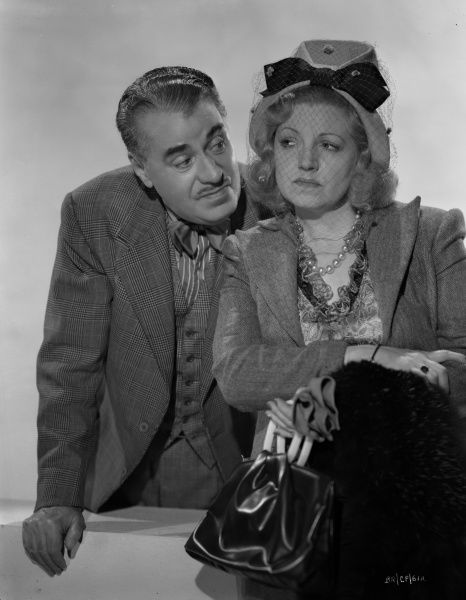 George Carney and Hermione Baddeley in a publicity image for the release of John Boulting's Brighton Rock where they played the roles of Phil Corkery and Ida Arnold