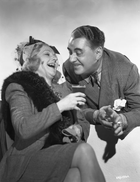 Hermione Baddeley and George Carney laugh in a promotional image for the release of John Boulting's Brighton Rock in 1947