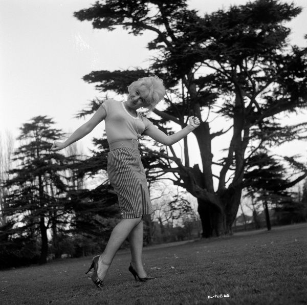 Gwendolyn Watts in a playful pose during a promotional shoot for the UK release of Billy Liar