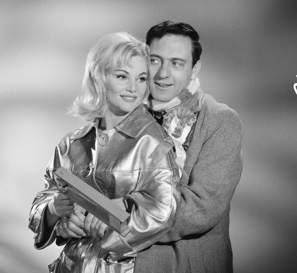 Diane Cilento and Harry H. Corbett in an image taken to promote Muriel Box's romantic comedy 'Rattle of a Simple Man' (1964)