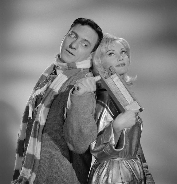 Harry H. Corbett as Percy Winthram and Diane Cilento as Cyrenne in a publicity image from Rattle of a Simple Man (1964)