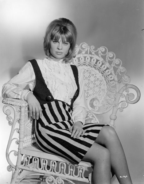 Julie Christie sits on a wicker chair for a portrait to promote the UK release of Billy Liar in 1963
