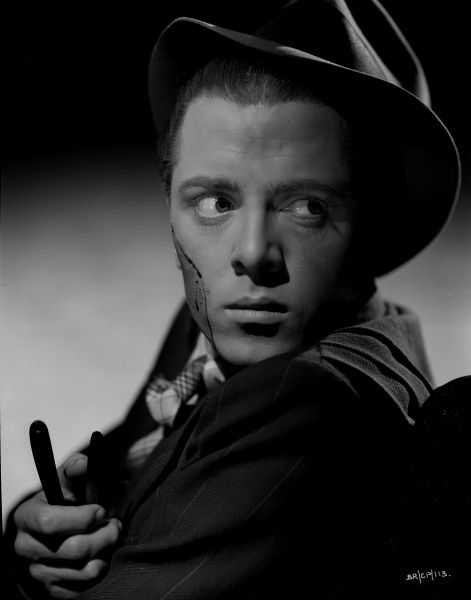 An intense portrait of Richard Attenborough as Pinkie in John Boulting's Brighton Rock. This image was used a reference for the theatrical artwork created by celebrated artist Tom Chantrell