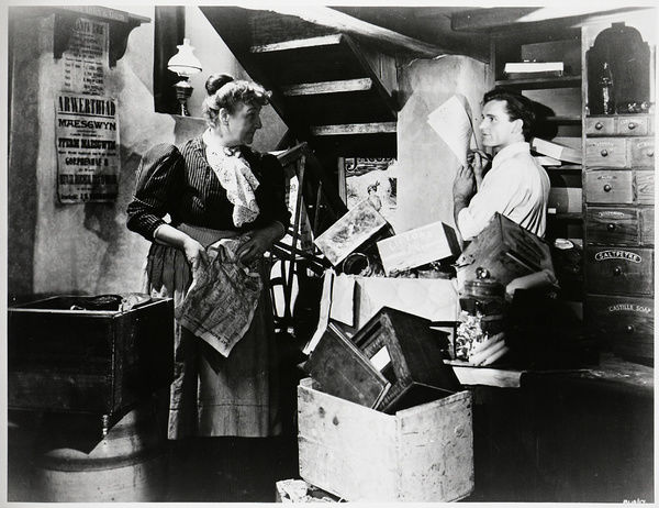Richard Burton as Gareth in the shop where his fictional character works in the film The Last Days of Dolwyn (1949)
