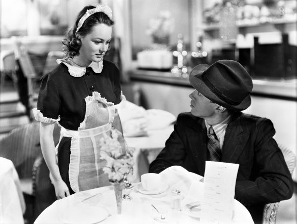 Carol Marsh and Richard Attenborough in a scene from John Boulting's noir film, based on Graham Greene's novel. Terence Rattigan contributed to the script