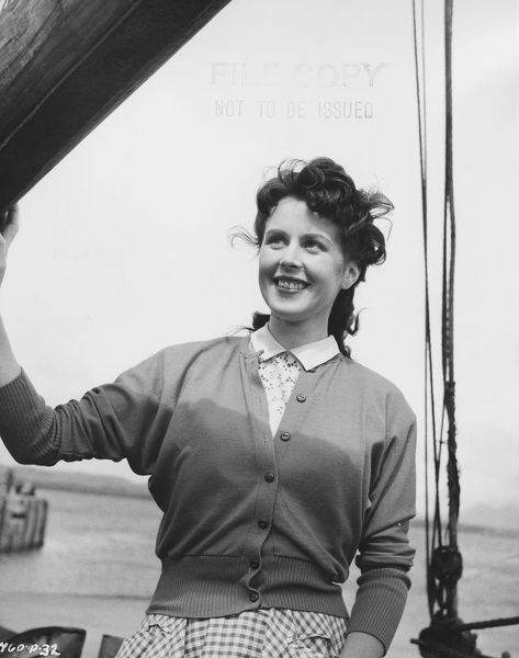 Sarah on the boat. in a scene from The Maggie (1954)