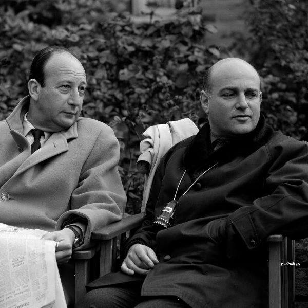 Producer Joseph Janni and director John Schlesinger take a pause on location during the filming of Billy Liar