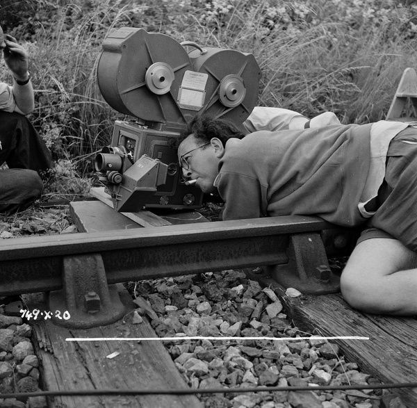 Douglas Slocombe sets up a shot for a scene from The Titfield Thunderbolt