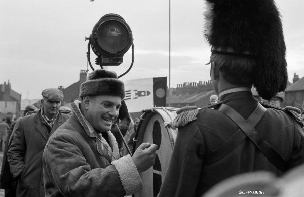 Director John Schlesinger smiles on the set of his film Billy Liar (1963) during a pause