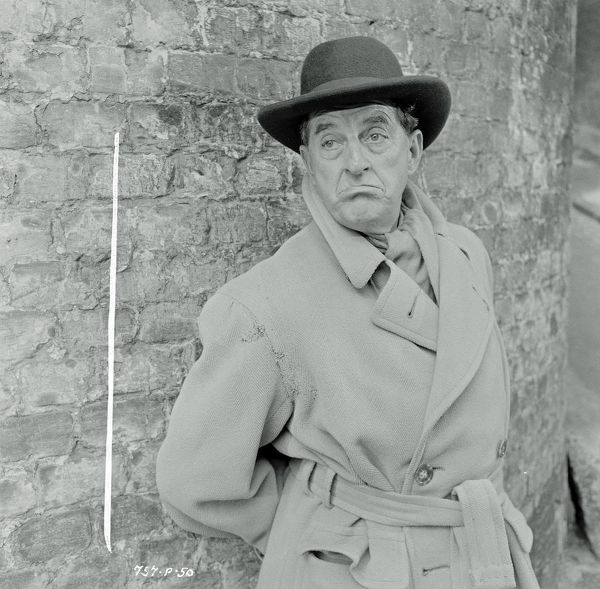 Stanley Holloway as Mr. Hollingsworth in Meet Mr. Lucifer (1953)
