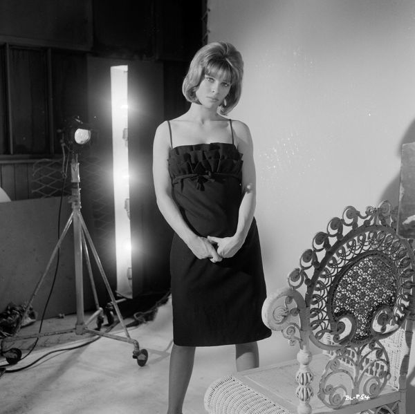 Julie Christie stands next to a wicker chair during the a publicity shoot for the promotion of the UK release of Billy Liar