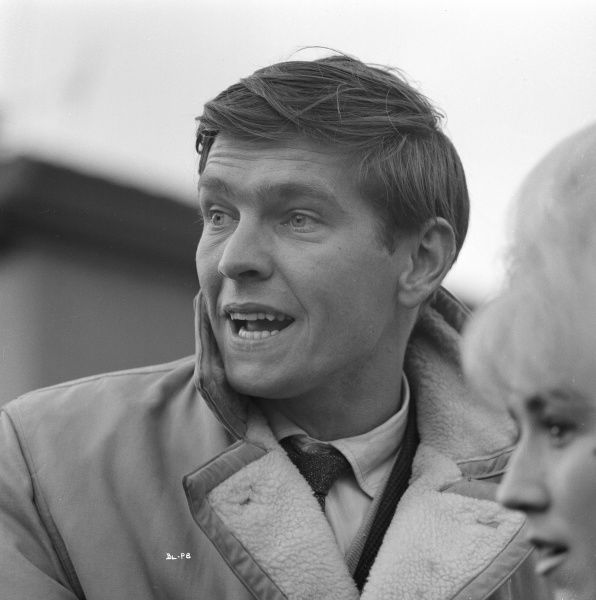 A candid portrait of Tom Courtenay on the set of Billy Liar, in the foreground Gwendolyn Watts