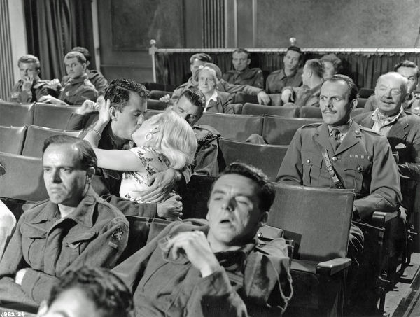 Major Hitchcock is not amused at the cinema in a scene from John Boulting's comedy
