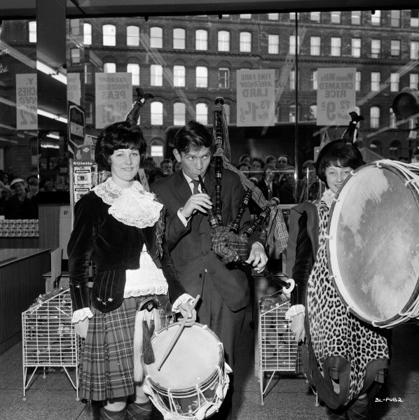 Tom Courtenay plays pretends to play the bagpipes during a pause of the filming of John Schlesinger's Billy Liar