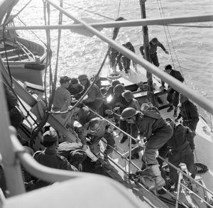 British soldiers board a Royal Navy ship
