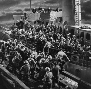 British soldiers board a ship at night
