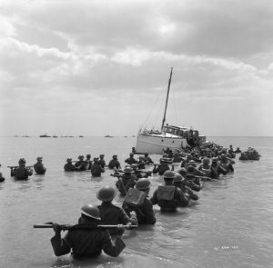 British soldiers try to board one of the small boats