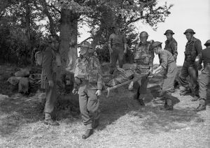 British soldiers around a wounded comrade