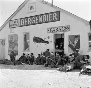 British troops at Dunkirk outside an abandoned cafe